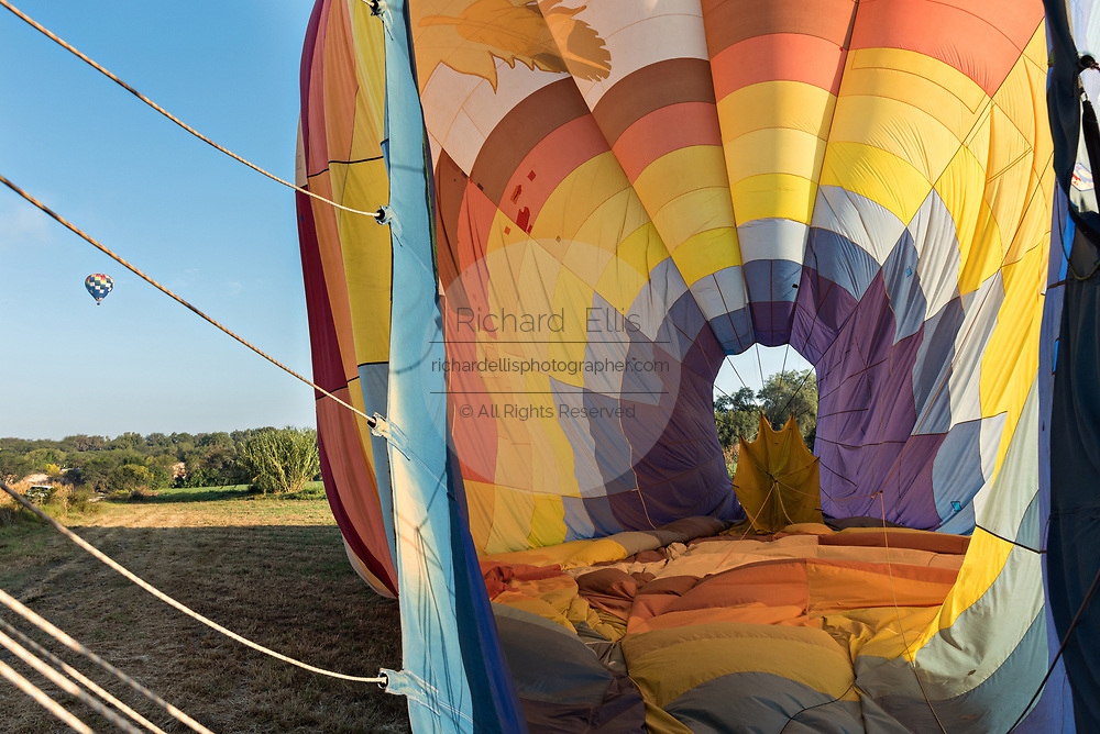 Ground crew begin deflating and securing a hot air balloon after landing outside the colonial city of San Miguel de Allende, Mexico.