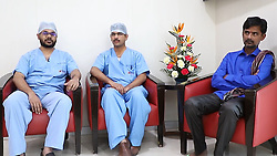 "By Sanjay Pandey in India for MailOnline This 40-year-old gritty man not only survived 12 hours with a 5ft long and tree branch lodged in his neck and head, but also managed to travel 60km with the (wood) staff to a private hospital in Bangalore, India. Farm labourer Nanjesha HN, who hails from Amruthur in Tumkur district of south Indian state of Karnataka, had met with a road accident and got himself impaled on the branch (3cm in diameter) on December 22. The staff pierced through his neck - entering from the left of the neck and exiting on the right side behind the ear. A team of doctors from Sparsh Hospital, Yeshwantpur, successfully removed the branch and saved his life. Four months on, the patient has recovered well and is able to narrate his own story. ""On December 22, I was riding a two-wheeler from my house and was heading toward Kunigal to attend the funeral of a relative. I veered to my left to avoid an oncoming truck. But I lost my balance and impaled myself on a dried up branch lying on the ground,"" said Nanjesha, still struggling to speak clearly. ""It pierced through my neck and emerged on the other side from behind my ear. I was bleeding profusely and had to keep my mouth wide open, gasping for breath. At that time, I didn't know whether I would live to see the next morning. But I never gave up and kept fighting for survival,"" he added. Luckily for Nanjesha, a passersby spotted him and called an ambulance. Though the vehicle reached in 20 minutes and he was taken to the nearby Kunigal government hospital, the doctors refused to take his case. ""The doctor didn't even touch me. I was still on the ambulance, so they decided to take me to another nearby hospital in Belluru Cross,"" Nanjesha recalled. From there, he was taken to a private medical college where doctors administered first aid. Since the patient's airways were obstructed, the doctors had to do a tracheostomy near his throat to provide an air passage to help him breathe. ""I w"