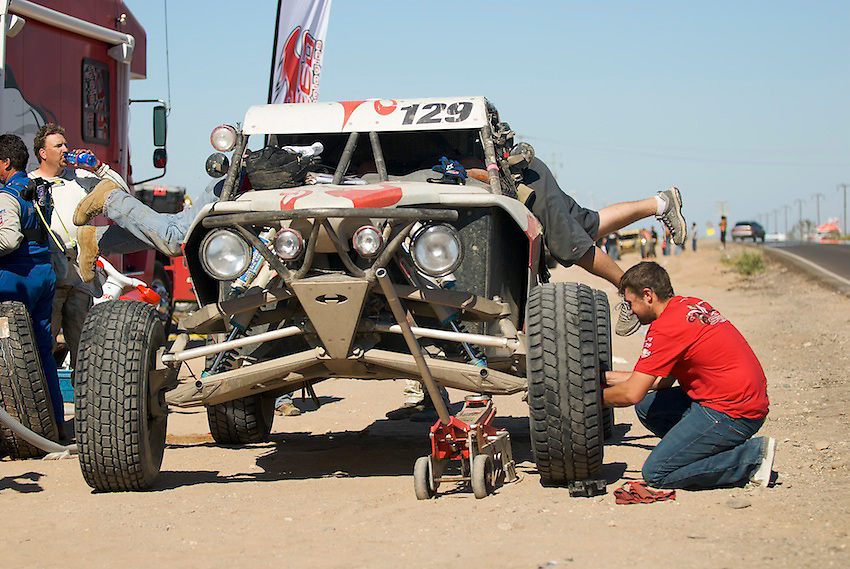 Speed Technologies HMS car gets tires, fuel and radio repairs at a pit deep in Baja during the 2007 Baja 1000.