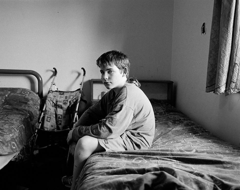 Damien in his bedroom where he is living in temporary accomodation with his family.; From Homeless Families Series.; Central Coast.; 2006.