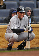 April 12, 2009:  Shortstop Derek Jeter #2 of the New York Yankees waits on deck during a game against the Kansas City Royals at Kauffman Stadium in Kansas City, Missouri.  The Royals defeated the Yankees 6-4.