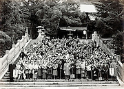 large company group trip posing on the stairs at a temple complex Japan 1960s