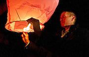 Robbie Parker prepares to release a lantern during the community memorial vigil at Ben Lomond High School in Ogden for Emilie Parker, one of the children murdered during the recent school shooting at Sandy Hook Elementary, Thursday, Dec. 20, 2012