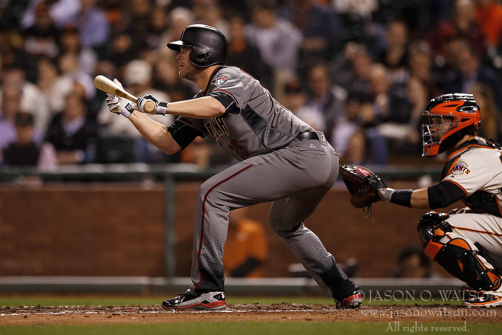 SAN FRANCISCO, CA - APRIL 18: Archie Bradley #25 of the Arizona Diamondbacks bunts against the San Francisco Giants during the fifth inning at AT&T Park on April 18, 2016 in San Francisco, California. The Arizona Diamondbacks defeated the San Francisco Giants 9-7 in 11 innings.  (Photo by Jason O. Watson/Getty Images) *** Local Caption *** Archie Bradley