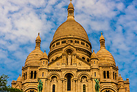 Sacre Coeur Basilica on Montmatre, a large hill (butte) in Northern Paris, France.