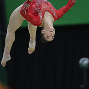Gymnastics - Olympics: Day 6  Alexandra Raisman #395 of the United States in action on the Balance Beam during her  silver medal performance in the Artistic Gymnastics Women's Individual All-Around Final at the Rio Olympic Arena on August 11, 2016 in Rio de Janeiro, Brazil. (Photo by Tim Clayton/Corbis via Getty Images)
