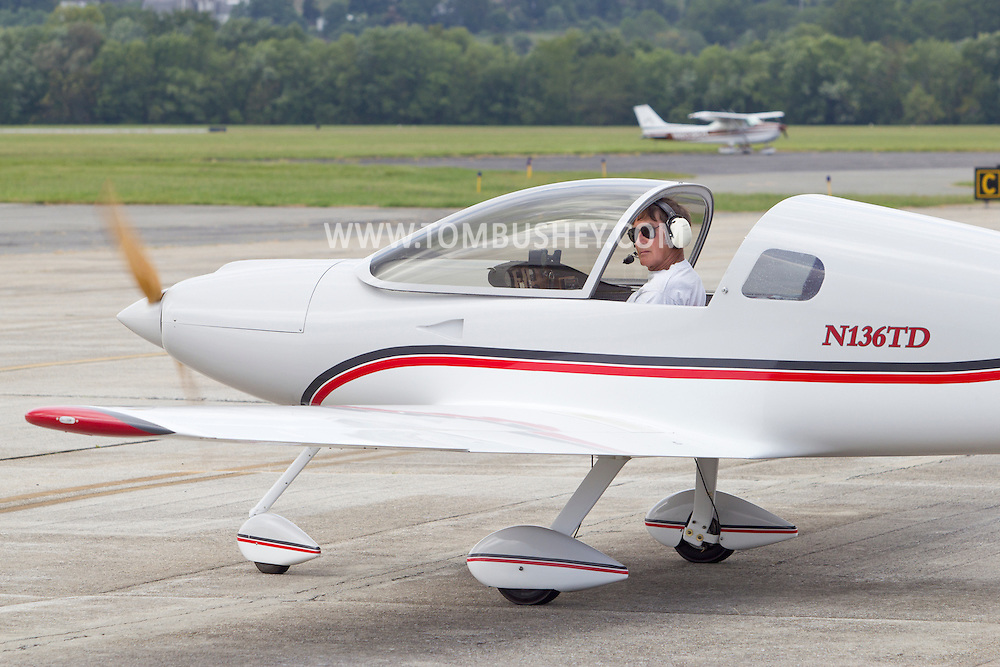 Montgomery, New York - A pilot taxis his single-engine plane before leaving the Experimental Aircraft Association (EAA) Chapter 501 fly-in at Orange County Airport on Sept. 8, 2012.