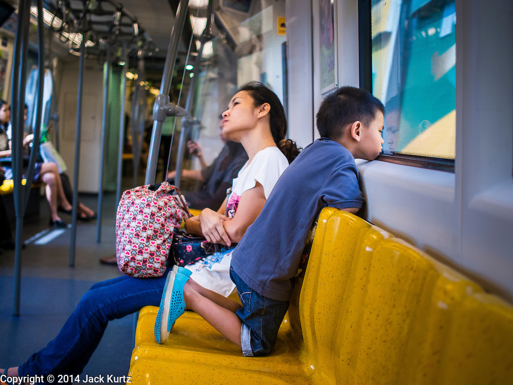 16 OCTOBER 2014 - BANGKOK, THAILAND: A woman and her child on the BTS (Skytrain) Silom line near the Surasak BTS station in Bangkok.     PHOTO BY JACK KURTZ
