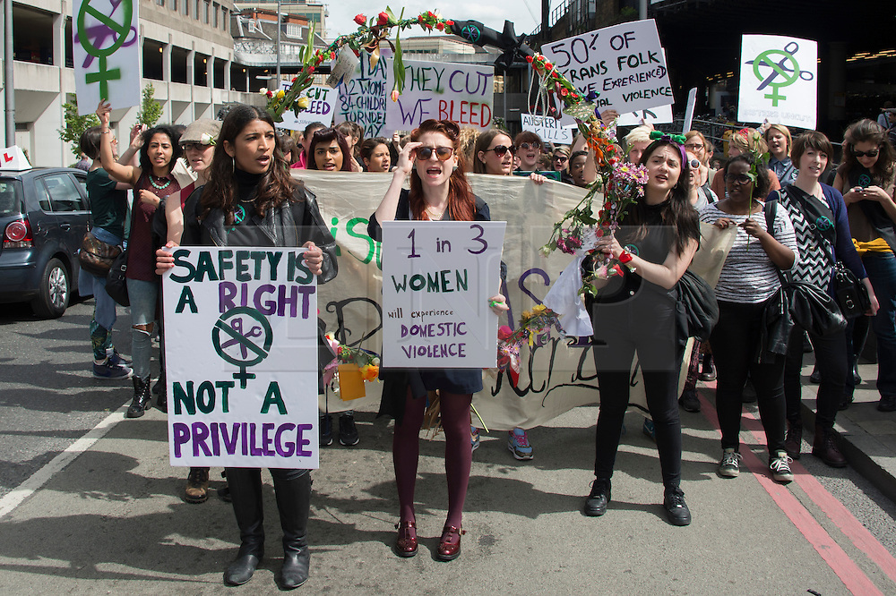 (c) Licensed to London News Pictures. 04/05/2015. London, UK. Sisters Uncut hold an anti-austerity rally and march in Southwark. Protesting that cuts will affect essential services such as domestic violence help. After holding a rally in The Scoop, at Queens Walk they matched to Southwark Street where they blocked the road as part of their direct action. Photo credit Simon Ford/LNP