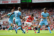 Arsenal's Alexis Sanchez being surrounded by Manchester City defence. Barclays Premier league match, Arsenal v Manchester city at the Emirates Stadium in London on Saturday 13th Sept 2014.<br /> pic by John Patrick Fletcher, Andrew Orchard sports photography.