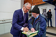 Ex Crystal Palace player Jim Cannon signs an autograph ahead of the Premier League match between Crystal Palace and Everton at Selhurst Park, London, England on 27 April 2019.