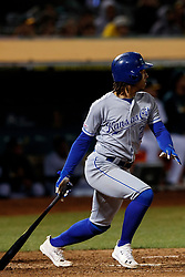 OAKLAND, CA - SEPTEMBER 16: Adalberto Mondesi #27 of the Kansas City Royals hits an RBI double against the Oakland Athletics during the ninth inning at the RingCentral Coliseum on September 16, 2019 in Oakland, California. The Kansas City Royals defeated the Oakland Athletics 6-5. (Photo by Jason O. Watson/Getty Images) *** Local Caption *** Adalberto Mondesi