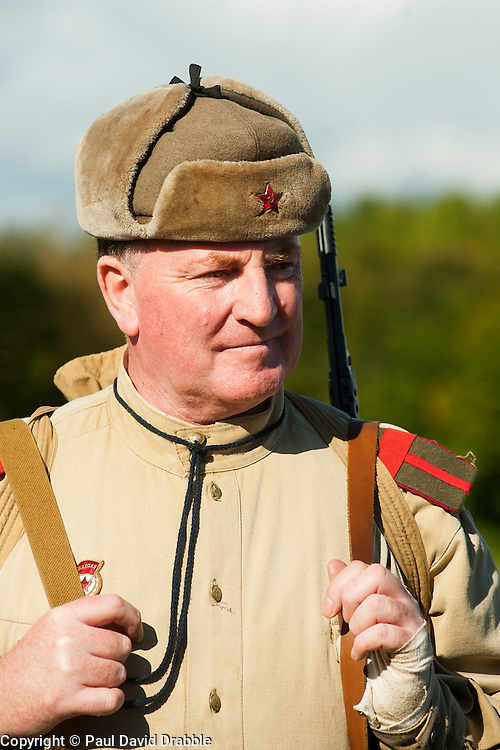 Re-enactors portraing Soviet soldiers from the Russian 13th Guards Rifle Division &quot;Poltavaskaya&quot; prepare for a Battle reenactment on Day one at the Showground Pickering  <br />