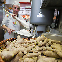 VENICE, ITALY - JUNE 30: Carlo Pistacchi of Gelateria Alaska in Santa Croce prepares a batch of Ginger ice cream on June 30, 2011 in Venice, Italy. Carlo has been making ice-cream using fresh ingredients for more than 25 years and is renowned for experimenting with new flavours, offering his customers classic favourites such as rum and raisin or chocolate as well as some of his more unconventional creations such as asparagus or rocket salad and orange.