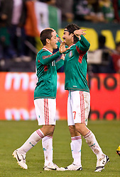 February 24, 2010; San Francisco, CA, USA;  Mexico forward Javier Hernandez (11) and midfielder Braulio Luna (7) celebrate after a goal against Bolivia during the first half at Candlestick Park. Mexico defeated Bolivia 5-0.