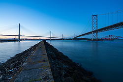 Evening view of new Queensferry Crossing , on left, Forth Road Bridge and Forth Railway Bridge in Scotland, United Kingdom