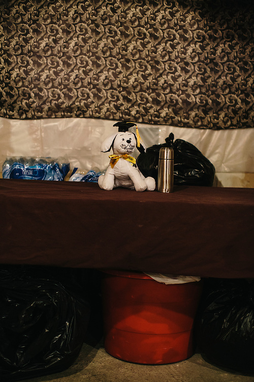 A stuffed animal as a congratulations for graduating, rests on a table in Marc Davis' basement room below his Mom's house in Washington DC. Davis, once worried his career path would be on the streets, mixed up with drug dealers, but after being mentored by UDC professor Dr. Daryao Khatri, Davis is now an algebra and geometry teacher at Woodrow Wilson High School in Washington DC.