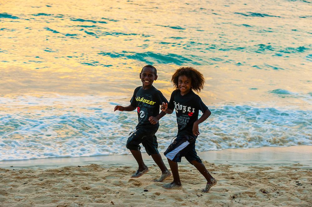Kanak children playing on the beach, Chateaubriand Bay, Lifou (island), Loyalty Islands, New Caledonia