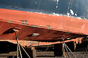 Rusting hull of an old commercial fishing boat in a shipyard, Gloucester, MA