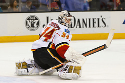 Feb 8, 2012; San Jose, CA, USA; Calgary Flames goalie Miikka Kiprusoff (34) warms up before the game against the San Jose Sharks at HP Pavilion. Mandatory Credit: Jason O. Watson-US PRESSWIRE