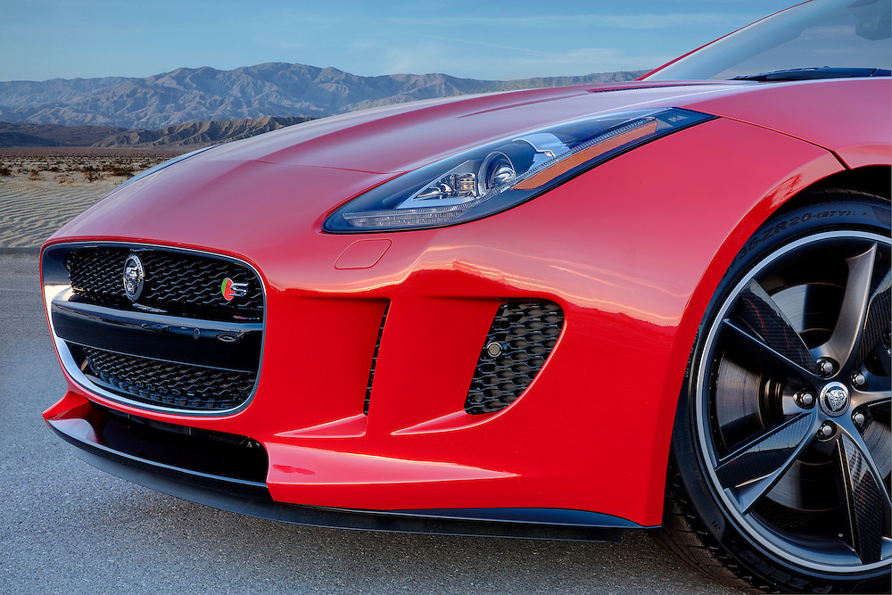 Close Up Profile of nose red 2014 Jaguar F-Type photographed in the Desert of Palm Springs, CA
