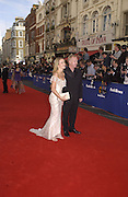 Les Dennis, Amanda Holden. TV Bafta Awards. 21 April 2002. © Copyright Photograph by Dafydd Jones 66 Stockwell Park Rd. London SW9 0DA Tel 020 7733 0108 www.dafjones.com