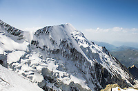 A wide angle view of Aiguille de Bionnassay on a sunny day, as seen from Dome du Gouter, on the classical route from Les Houches to the summit of Mont Blanc.