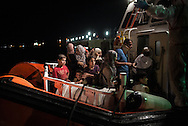 Night landing in Augusta. Syrians escaping from the conflict after 8 navigation day