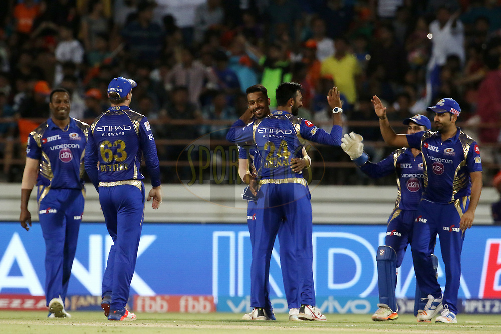Mumbai Indians players celebrates the wicket of Irfan Pathan of the Gujarat Lions during match 35 of the Vivo 2017 Indian Premier League between the Gujarat Lions and the Mumbai Indians  held at the Saurashtra Cricket Association Stadium in Rajkot, India on the 29th April 2017<br /> <br /> Photo by Vipin Pawar - Sportzpics - IPL
