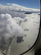 View from cabin through window of international airliner of coastal line Holland