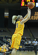December 30, 2011: Iowa Hawkeyes guard Melissa Dixon (21) puts up a three point shot during the NCAA women's basketball game between the Northwestern Wildcats and the Iowa Hawkeyes at Carver-Hawkeye Arena in Iowa City, Iowa on Wednesday, December 30, 2011.