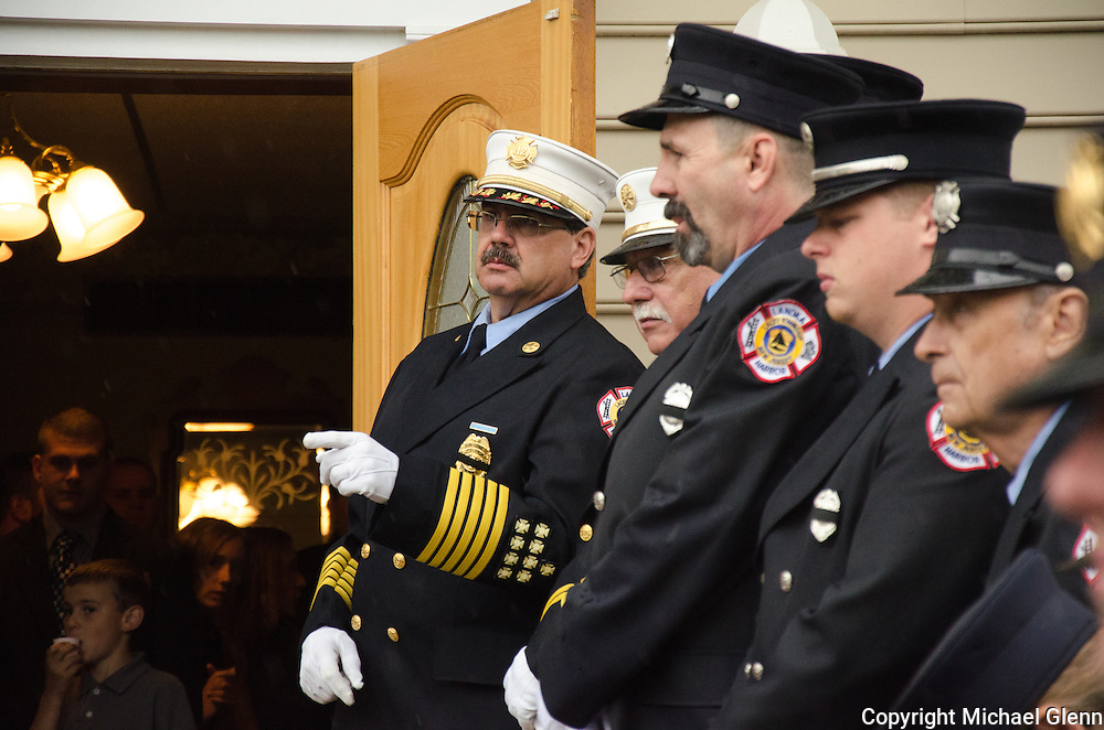 10Jun2013/Lanoka Harbor/NJ/USA/Funeral Service for LHFD Chief Kevin Perrone who died suddenly after a s battle with Kidney failure. Firefighters line up outside Riggs funeral home
