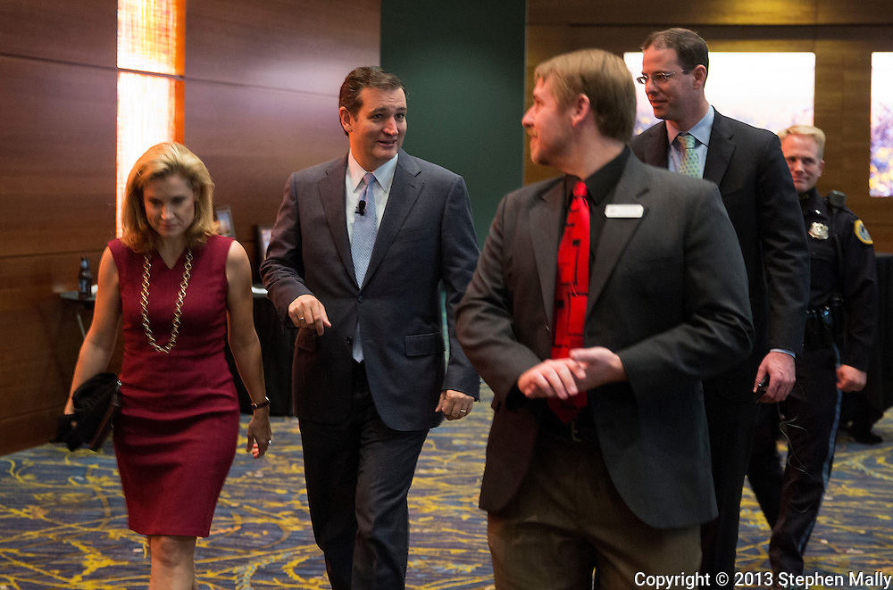 DES MOINES, IA - OCTOBER 25, 2013: Senator Ted Cruz, Republican of Texas, walks with his Heidi Nelson Cruz (left) during the Iowa GOP Ronald Reagan Dinner at the Iowa Events Center - Community Choice Credit Union Convention Center in Des Moines, Iowa.