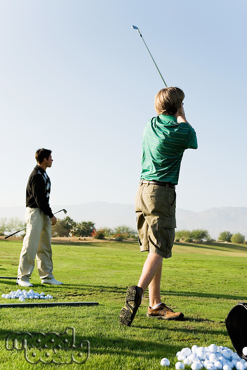 Young Men at Driving Range