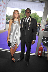 Footballer Djibril Cisse and his wife JUDE at The Butterfly Ball in aid of the Caudwell Children Charity held in Battersea park, London on 14th May 2009.