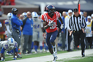 Ole Miss' Vince Sanders (10) breaks away from Presbyterian's Cory White (20) to score at Vaught-Hemingway Stadium in Oxford, Miss. on Saturday, November 8, 2014. (AP Photo/Oxford Eagle, Bruce Newman)