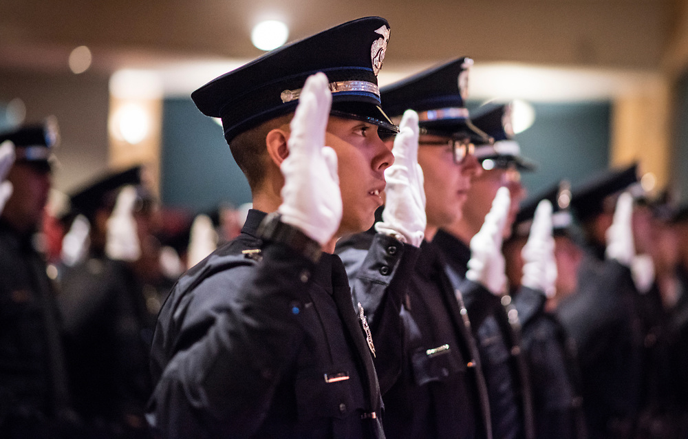 rer06017c/metro/June 01, 2017/Albuquerque Journal<br /> The Albuquerque PoliceDepartment 117TH Cadet Class Graduation took place Thursday morning with a total of 31 cadets taking the oath to serve the cities of Albuquerque and Rio Rancho.  Pictured is APD cadet Richard Anderson(Cq)taking the oath during the ceremony. <br />  Roberto E. Rosales/Albuquerque Journal