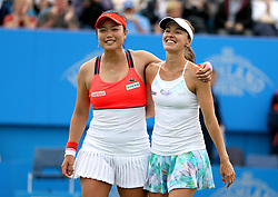 Chinese Taipei's Yung-jan Chan (left) and Switzerland's Martina Hingis (right) celebrate winning against Australia's Ashleigh Barty and Casey Dellacqua in the Women's Doubles Final during day nine of the AEGON International at Devonshire Park, Eastbourne.