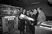 Dickie Rock and other members of the Miami Showband check their pictures at Baily Gibson Printers. .02.12.1964