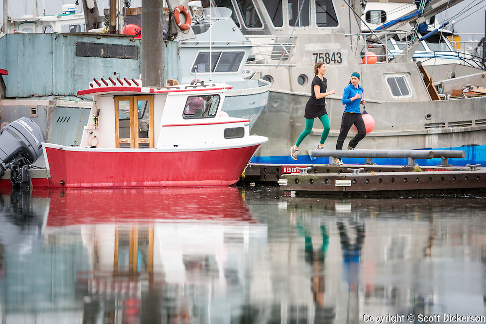 Homer Women's Nordic doing dryland training for cross country skiing in the Homer harbor, Homer, Alaska.