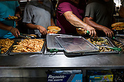 Philadelphia, Pennsylvania - September 17, 2015: Workers grab lunch inside the crew tent Thursday September 17th, 2015. <br /> <br /> <br /> Scott Mirkin's company ESM is heading the production of The World Meeting Of Families and Pope Francis's visit to Philadelphia this Fall. The events will take place along the Benjamin Franklin Parkway.<br /> <br /> CREDIT: Matt Roth for The New York Times<br /> Assignment ID: 30179397A