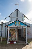 Calais, Pas-de-Calais, France - 17.10.2016    <br />     <br />  Christian church of Eritrean refugees in the &rdquo;Jungle&quot; refugee camp on the outskirts of the French city of Calais. Many thousands of migrants and refugees are waiting in some cases for years in the port city in the hope of being able to cross the English Channel to Britain. French authorities announced that they will shortly evict the camp where currently up to up to 10,000 people live.<br /> <br /> Christliche Kirche von Fluechtlingen aus Eritrea im &rdquo;Jungle&rdquo; Fluechtlingscamp am Rande der franzoesischen Stadt Calais. Viele tausend Migranten und Fluechtlinge harren teilweise seit Jahren in der Hafenstadt aus in der Hoffnung den Aermelkanal nach Gro&szlig;britannien ueberqueren zu koennen. Die franzoesischen Behoerden kuendigten an, dass sie das Camp, indem derzeit bis zu bis zu 10.000 Menschen leben K&uuml;rze raeumen werden. <br /> <br /> Photo: Bjoern Kietzmann