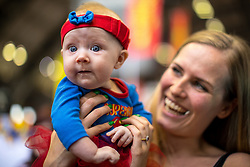 © Licensed to London News Pictures . 30/07/2017 . Manchester , UK . Supergirl (Freyja McGarry - correct - 14 weeks old) with her mother Katja Wallman (30) (from Oldham) . Cosplayers, families and guests at Comic Con at the Manchester Central Convention Centre . Photo credit : Joel Goodman/LNP