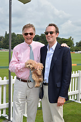 Left to right, JOHNNY KIDD and FRITZ VON WESTENHOLZ with his dog Swifty at the Veuve Clicquot Gold Cup Final at Cowdray Park Polo Club, Midhurst, West Sussex on 20th July 2014.