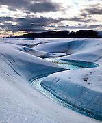 Blue Melt River, Petermann Glacier, in remote northwestern Greenland, on Nares Strait. In 2010 and 2012 Petermann calved ice islands totalling 400 square kilometres. (c) 2009 Dave Walsh