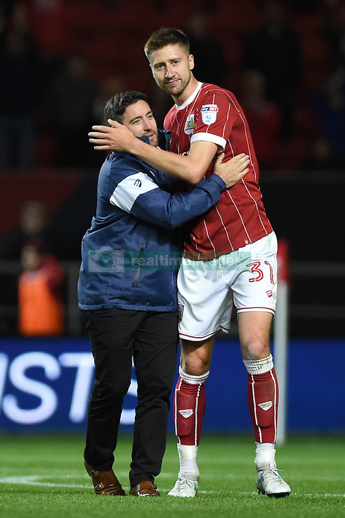 Bristol City manager Lee Johnson and Bristol City's Jens Hegeler celebrate after the Carabao Cup, third round match at Ashton Gate Stadium, Bristol.