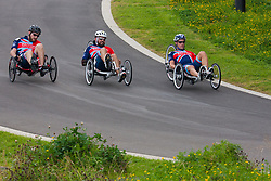 Queen Elizabeth Olympic Park, London. September 13th 2014. In the Recumbent IRecB1category, Robert Cromey-Hawke (R), John-James Chalmers (L) and Paul Vice (C) use teamwork to build a commanding lead as wounded servicemen and women from 13 different countries compete for sporting glory during the cycling competition at the Invictus Games.