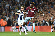 West Bromwich Albion midfielder (on loan from Fulham) Stefan Johansen (6) tackles Aston Villa striker(on loan from Chelsea) Tammy Abraham (18) during the EFL Sky Bet Championship play-off second leg match between West Bromwich Albion and Aston Villa at The Hawthorns, West Bromwich, England on 14 May 2019.