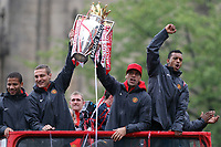 Football - Manchester United Premier League Champions Parade<br /> Bebe, Nemanja Vidic, Rio Ferdinand and Nani celebrate with the trophy on Deansgate, Manchester