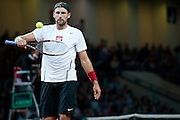 Lukasz Kubot of Poland in action during the BNP Paribas Davis Cup 2013 between Poland and Australia at Torwar Hall in Warsaw on September 15, 2013.<br /> <br /> Poland, Warsaw, September 15, 2013<br /> <br /> Picture also available in RAW (NEF) or TIFF format on special request.<br /> <br /> For editorial use only. Any commercial or promotional use requires permission.<br /> <br /> Photo by &copy; Adam Nurkiewicz / Mediasport